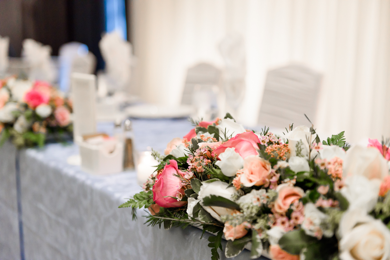 Pictures of wedding venue and flower table decoration taken at Ajax Convention Center