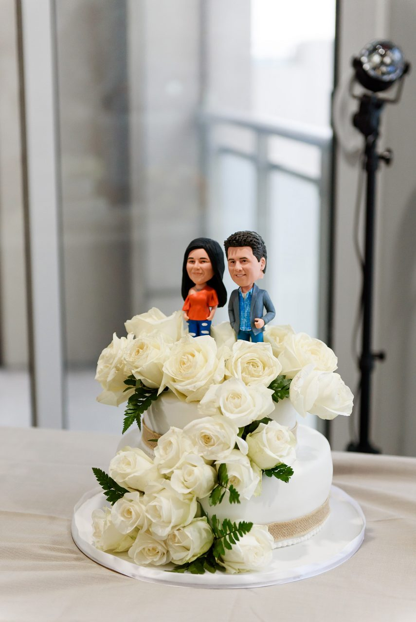 wedding cake with bobbleheads standing at the top