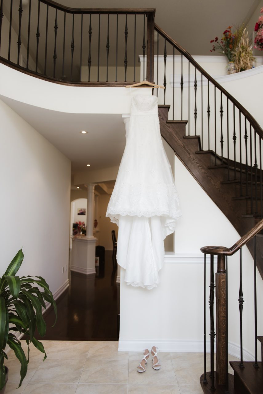 wedding dress hanging at the hallway