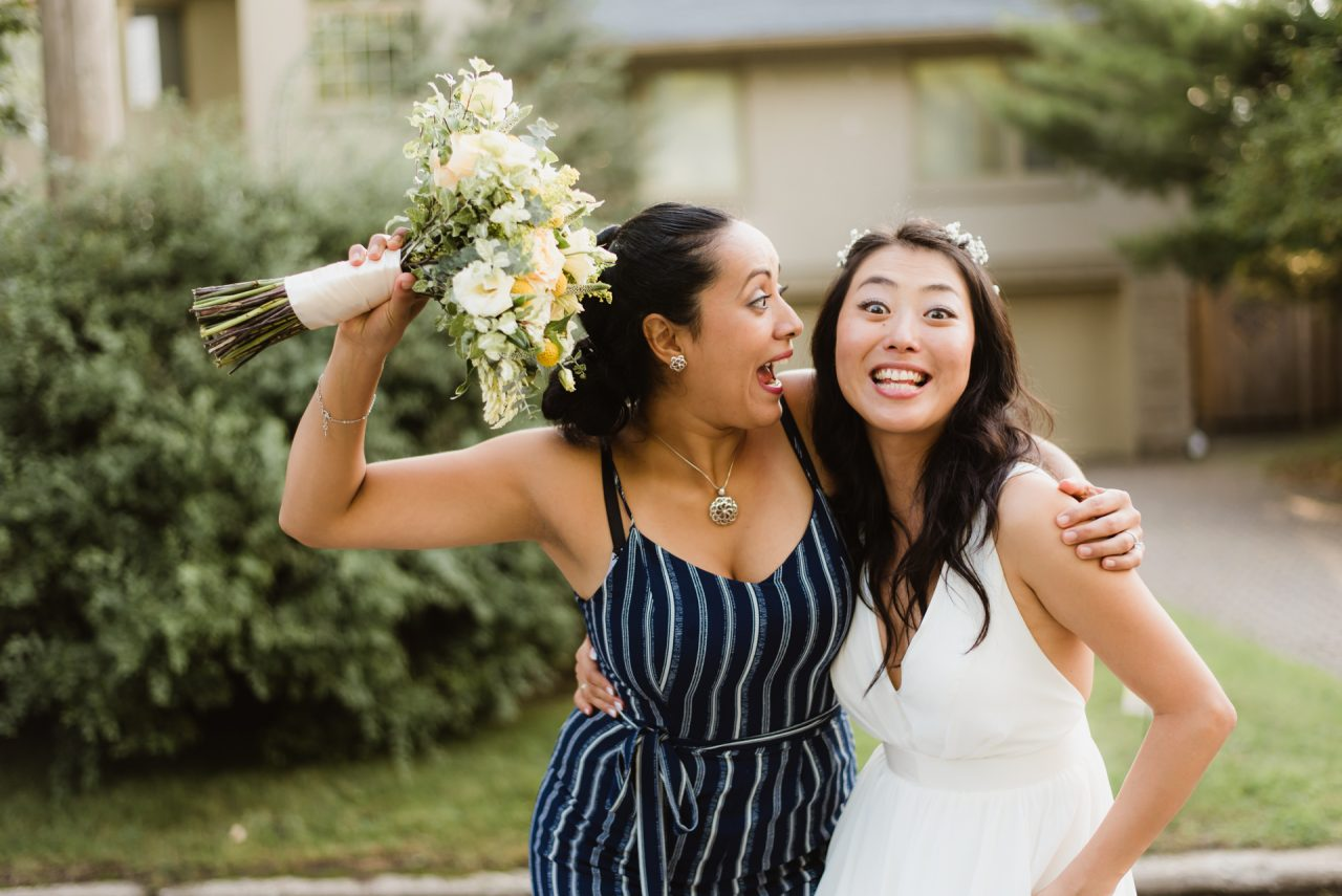 bride and made of honor funny poses Toronto