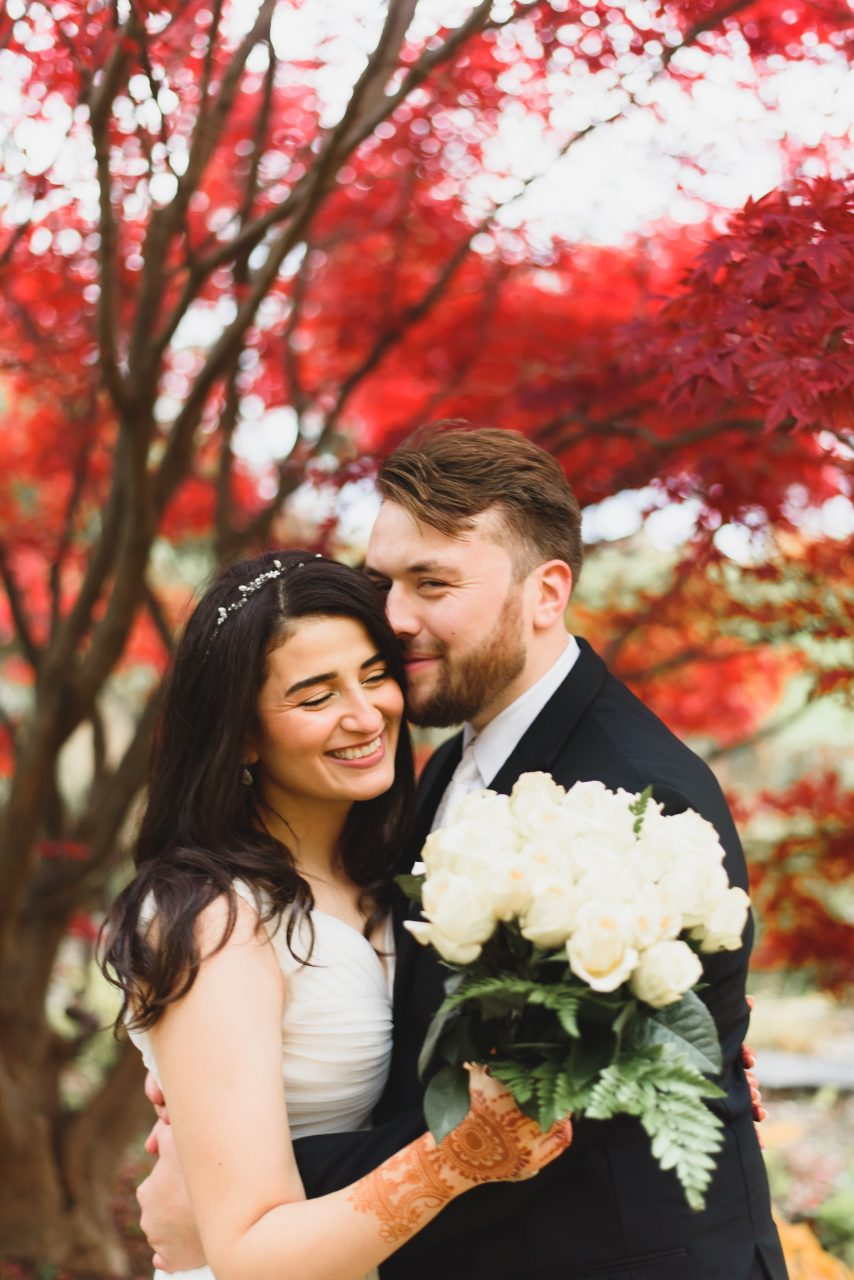 wedding picture taken in fall season at the Centennial park, Toronto showing bride and groom