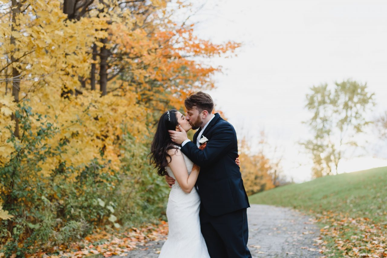 picture showing bride and groom, candid moments during their wedding photo shoot taken in Toronto GTA area