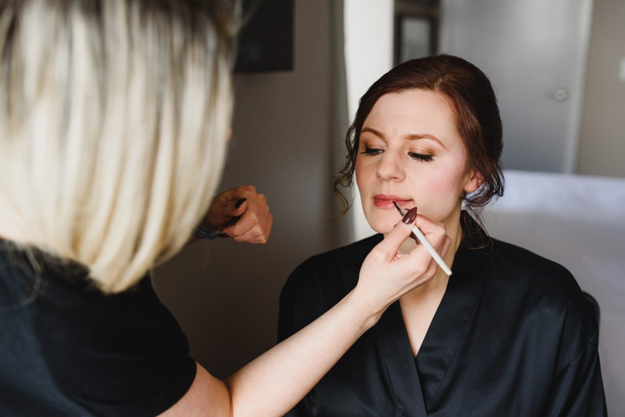 picture of the bride getting ready at at One West Hotel downtown Toronto Beauty Group