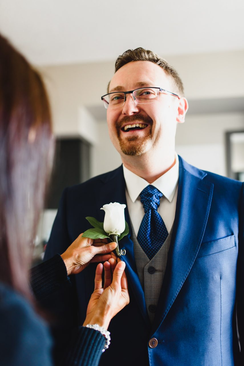 groom getting ready at One King West Hotel