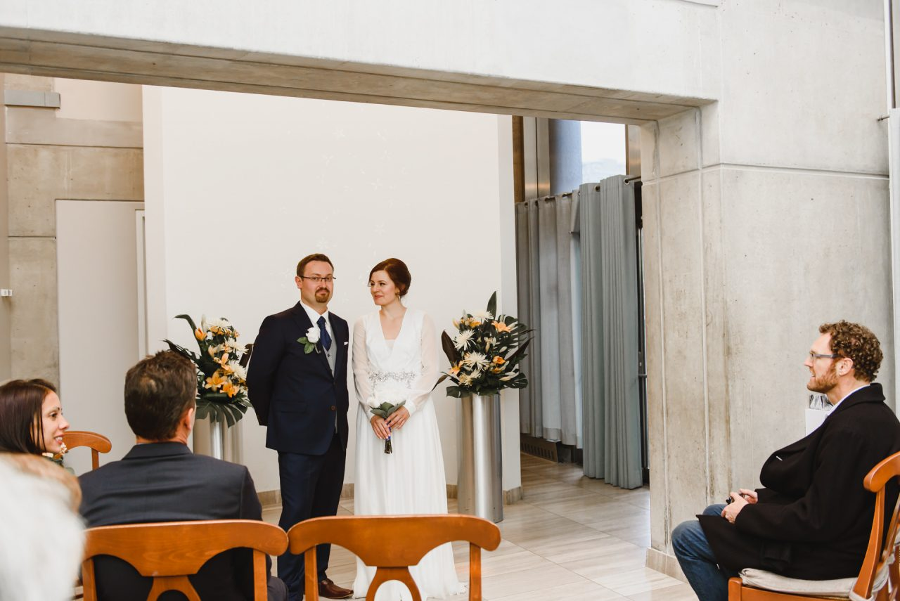 bride and groom waiting in the Toronto City Hall to get married