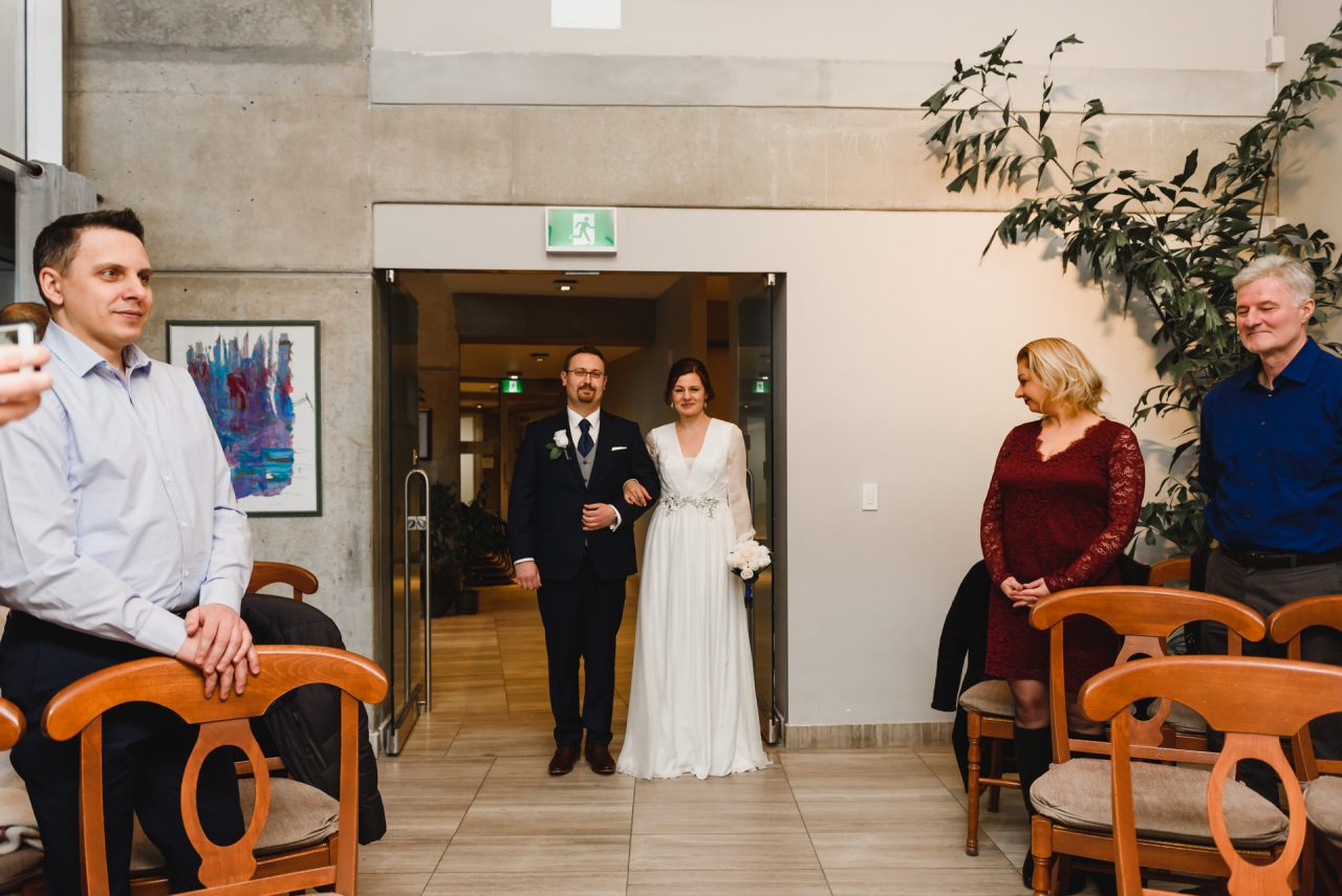 wedding picture of the bride and groom taken at the City Hall Toronto
