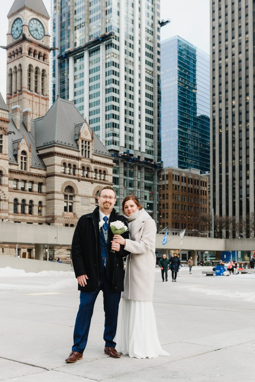 wedding picture in front of the Toronto City Hall