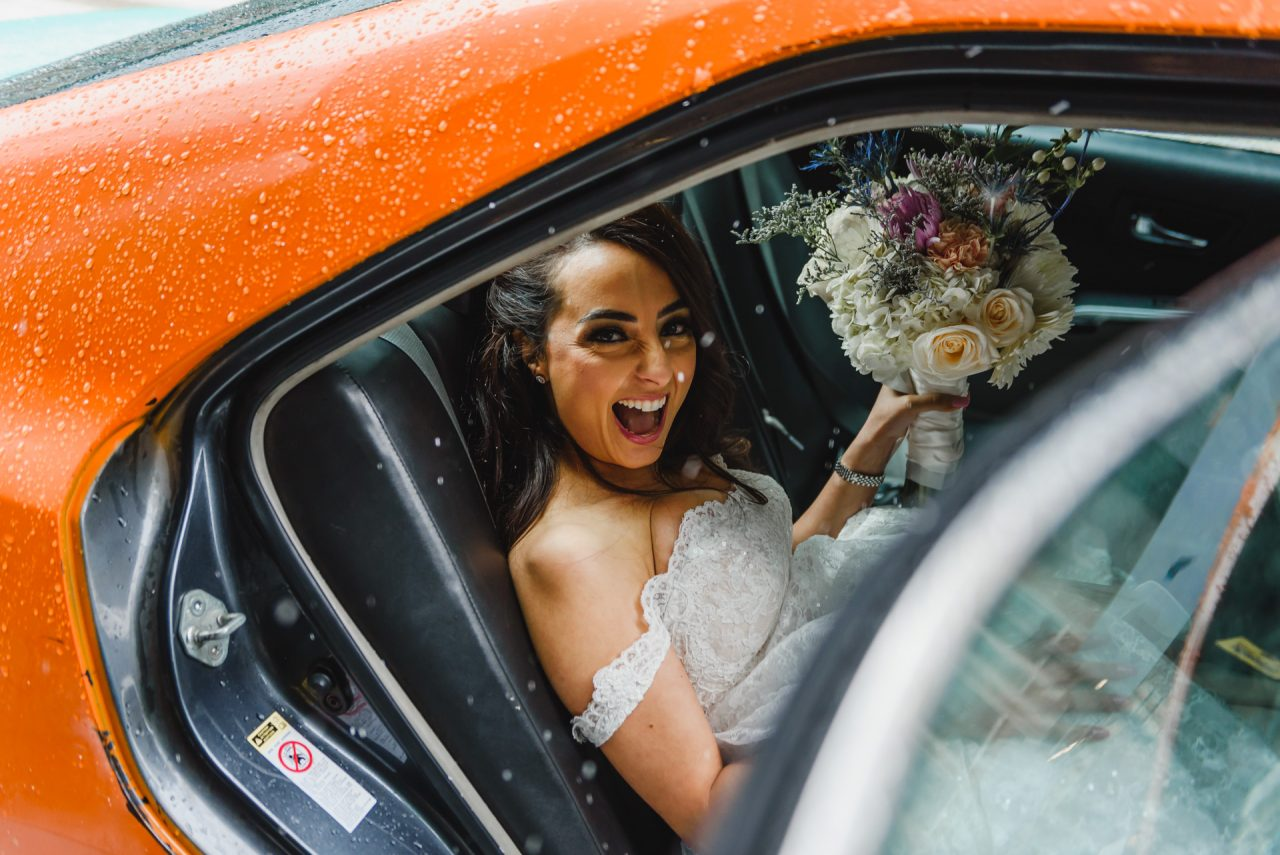 candid wedding picture taken in cab downtown Toronto