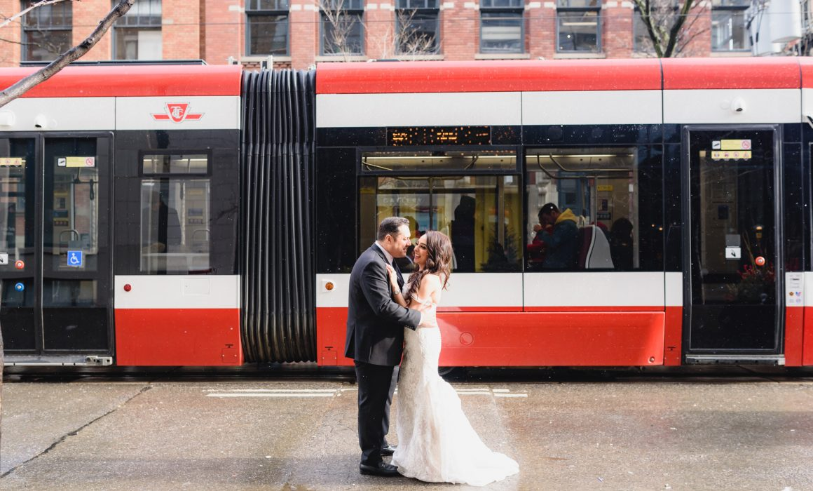 wedding photo shoot taken with street cars downtown Toronto at King Street