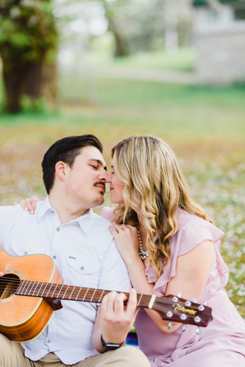 engagement pictures with the guitar at cherry blossom season High Park, Toronto