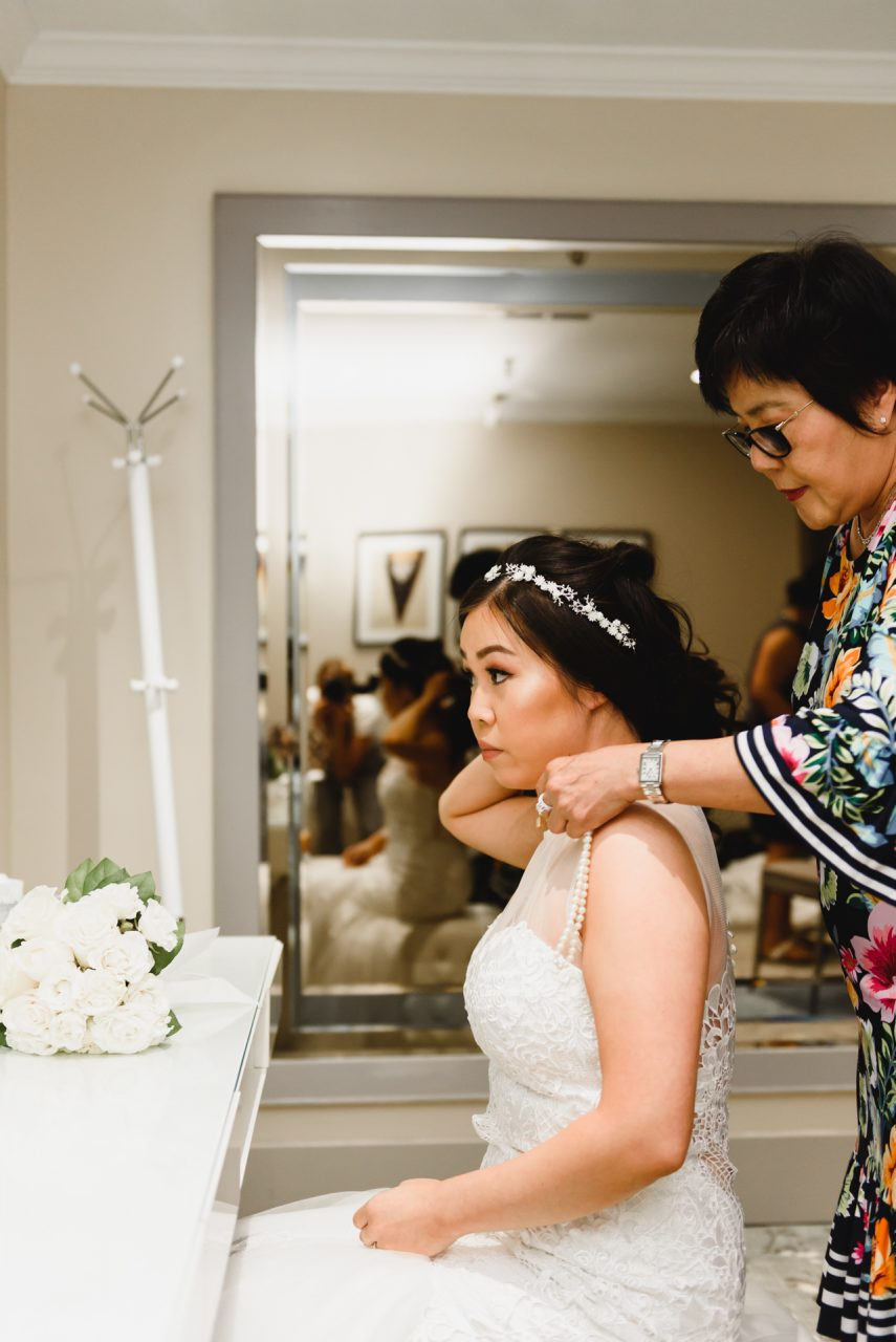 wedding photo of bride getting ready at Bayview Golf and Country Club