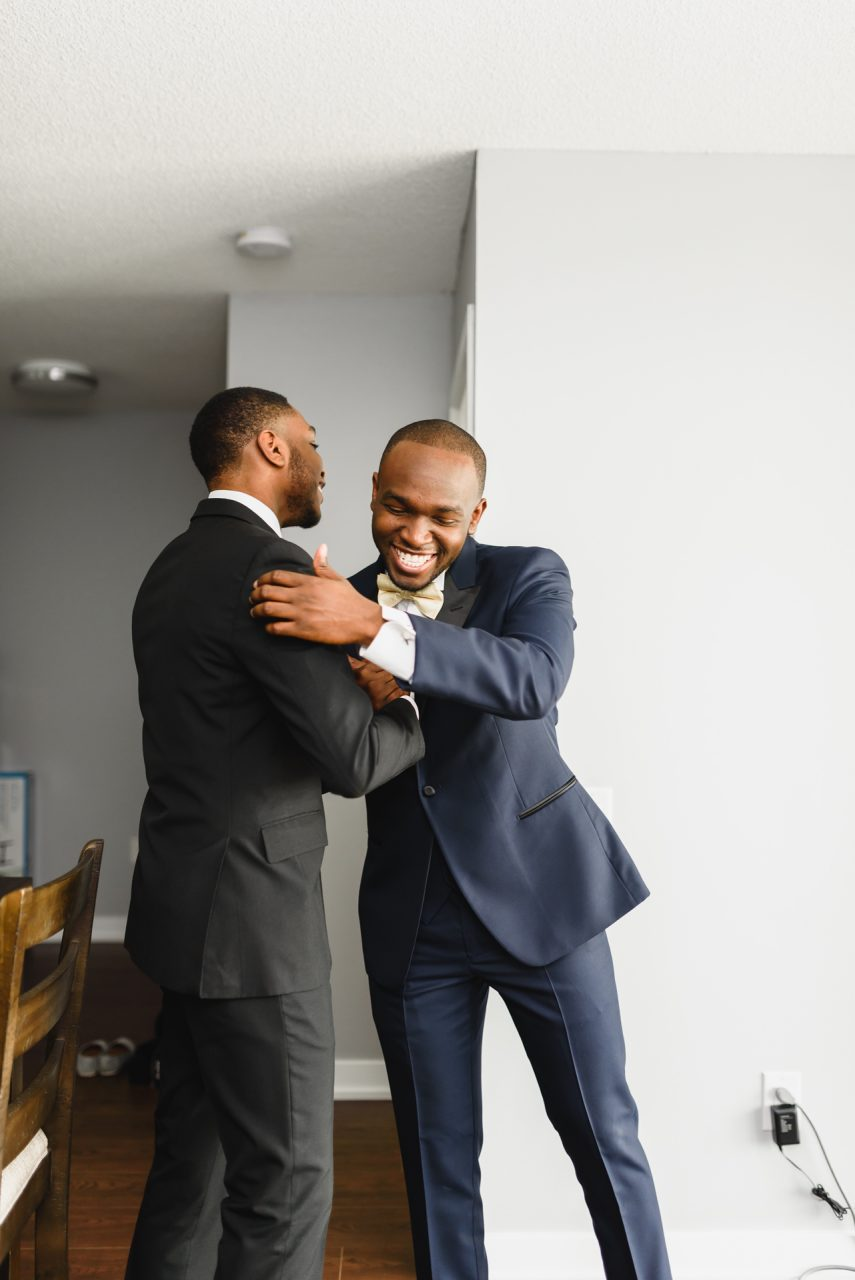 groom is getting ready at home in Toronto with his brother and best man