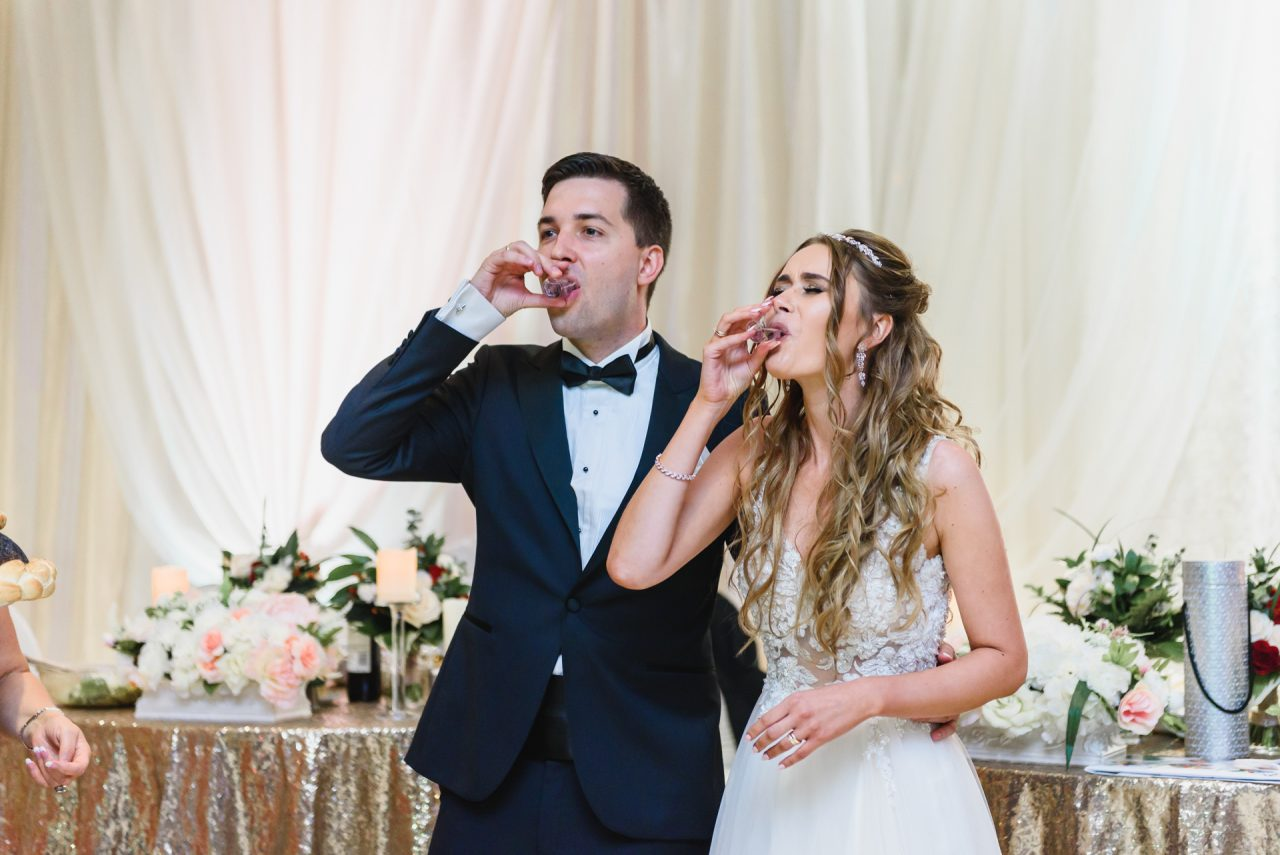 bride and groom during wedding reception at Serbian Centre in Windsor