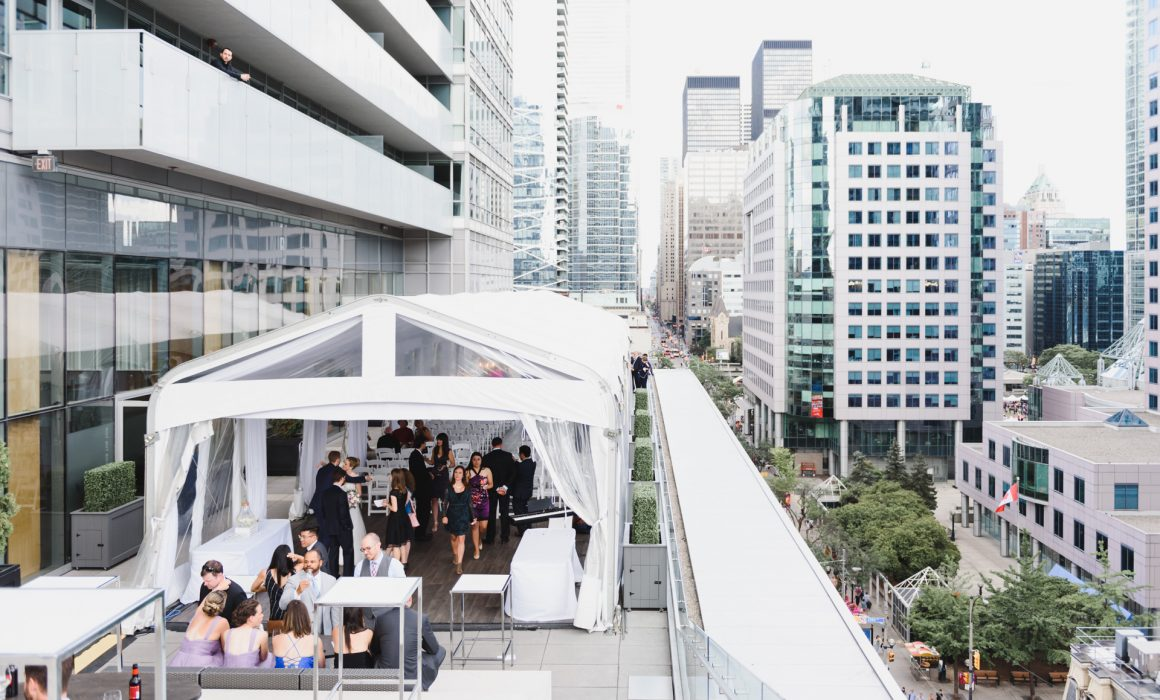 Malaparte events picture taken outdoor ta the terrace with downtown Toronto lookout