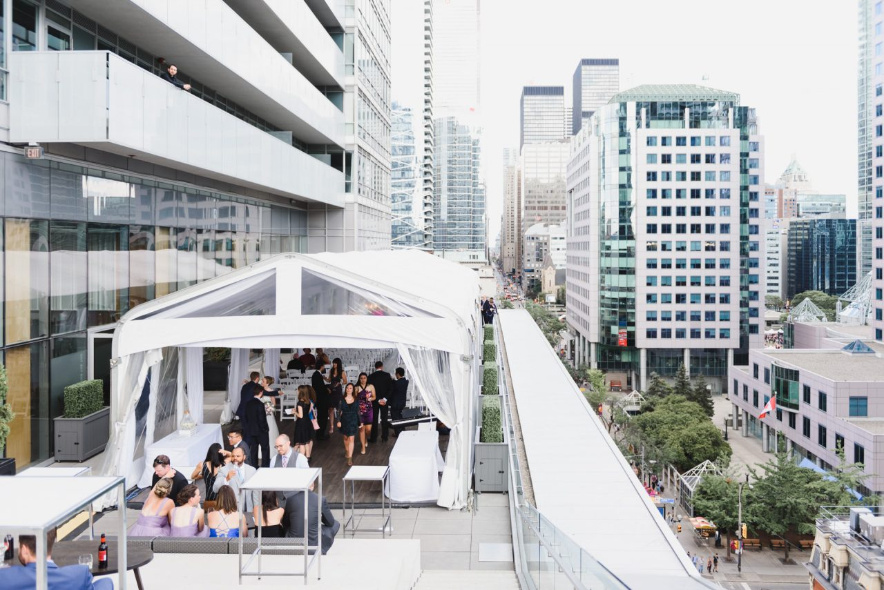 Malaparte events picture taken outdoor at the terrace during wedding with downtown Toronto lookout