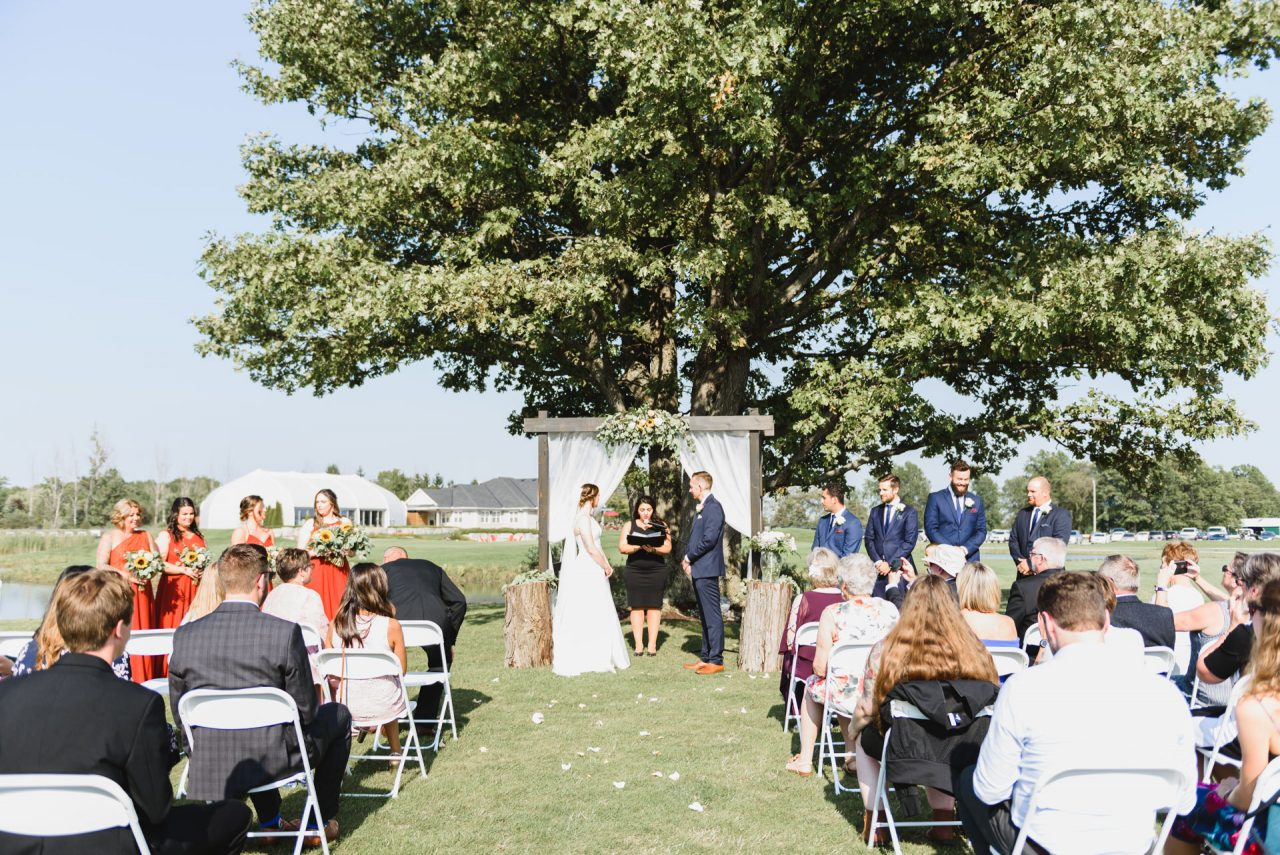 outdoor wedding ceremony at Cardinal Lakes Golf Club, Welland Niagara taken by Niagara wedding photographer