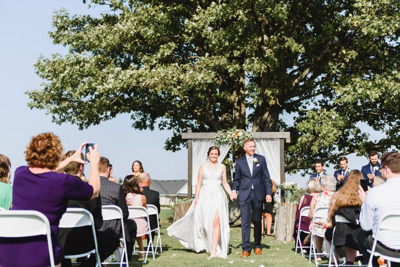 bride and groom during outdoor wedding ceremony at Cardinal Lakes Golf Club, Welland Niagara