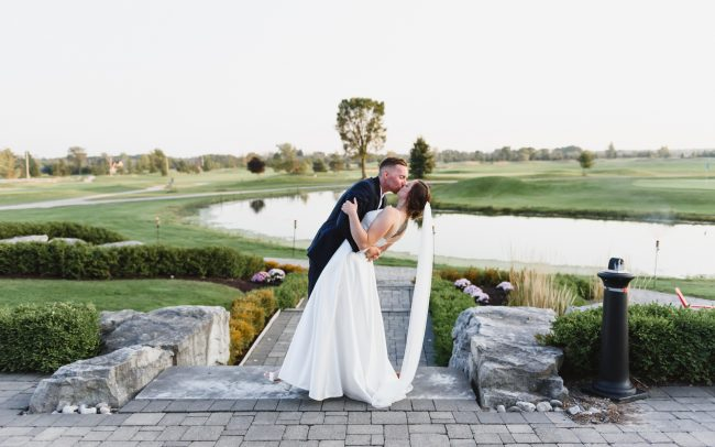 wedding picture of bride and groom taken at Cardinal Lakes Golf Club at Welland by Toronto wedding photographer