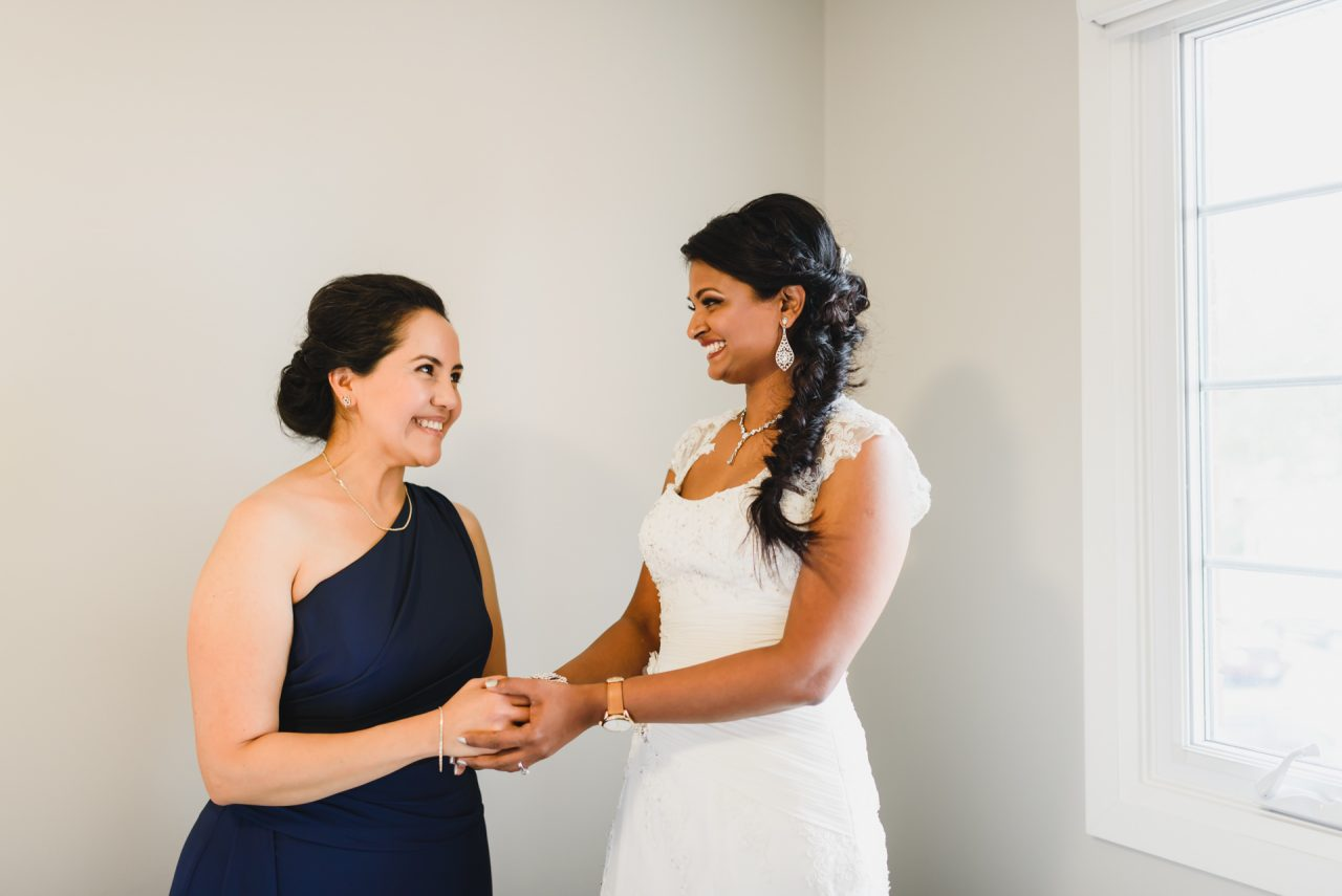 bride getting ready with maid of honor