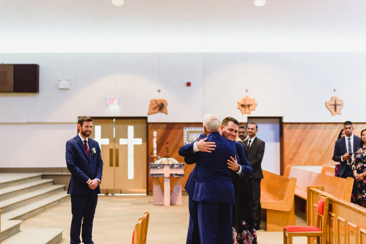 wedding ceremony at Our Lady of the Airways Catholic Church