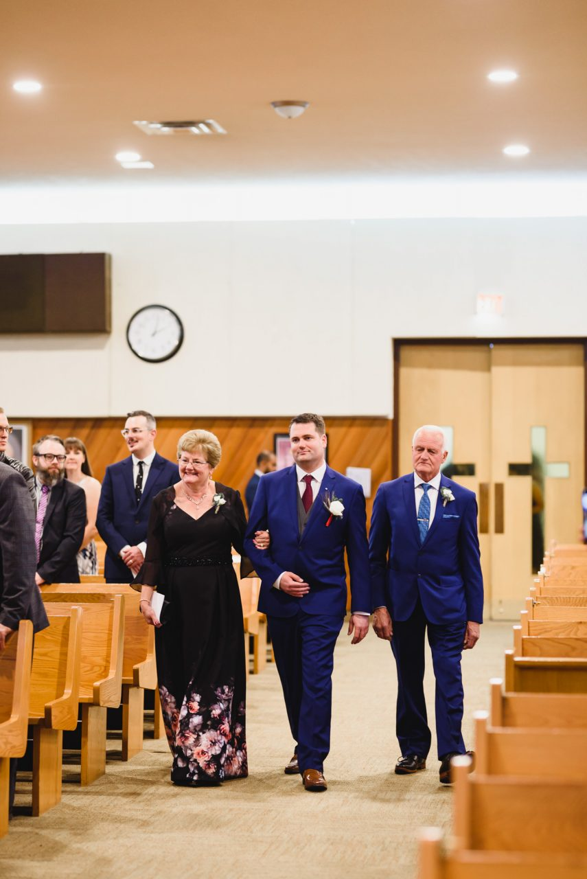 wedding ceremony at Our Lady of the Airways Catholic Church, groom with parents