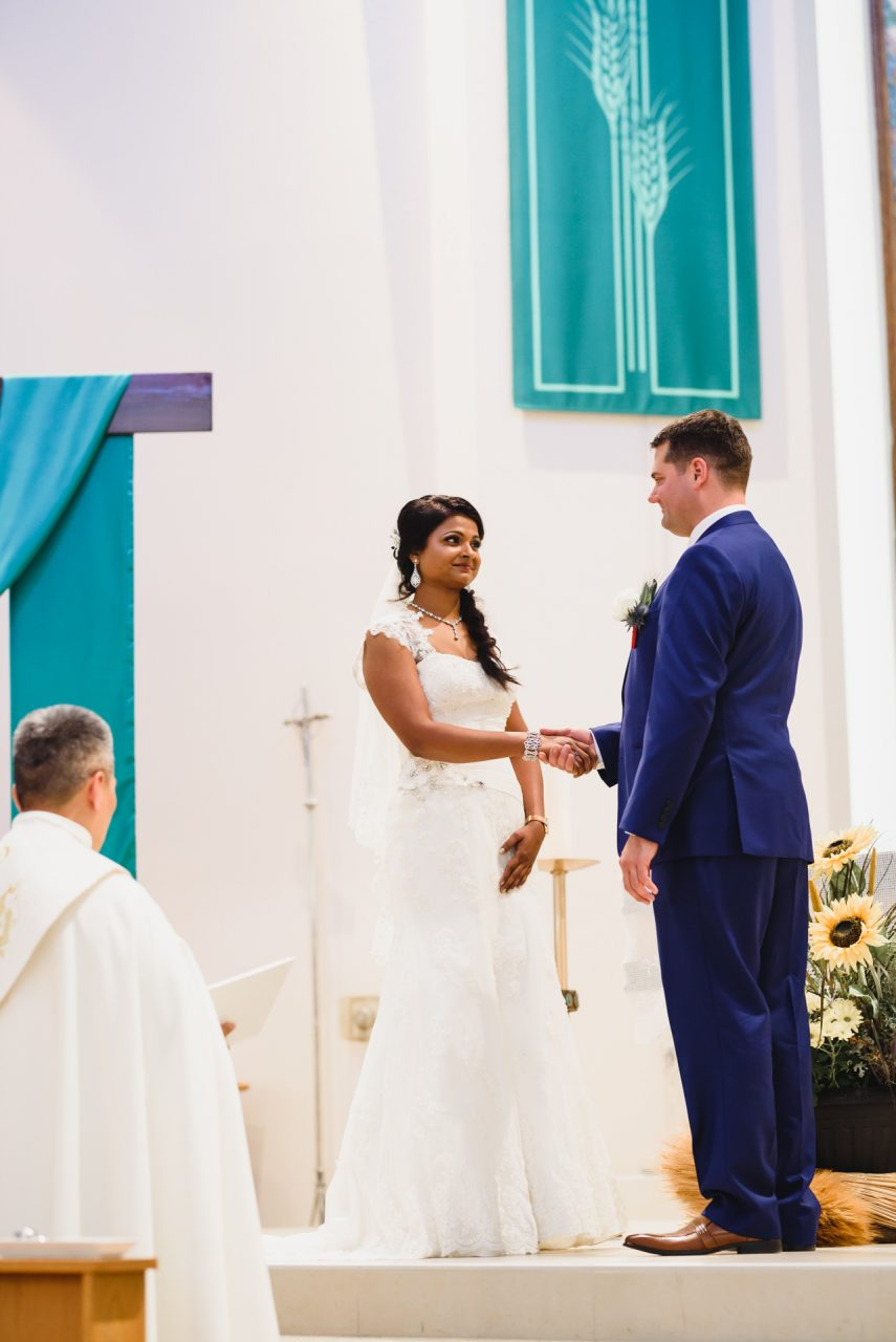 bride and groom during wedding ceremony at wedding ceremony at Our Lady of the Airways Catholic Church in Mississauga