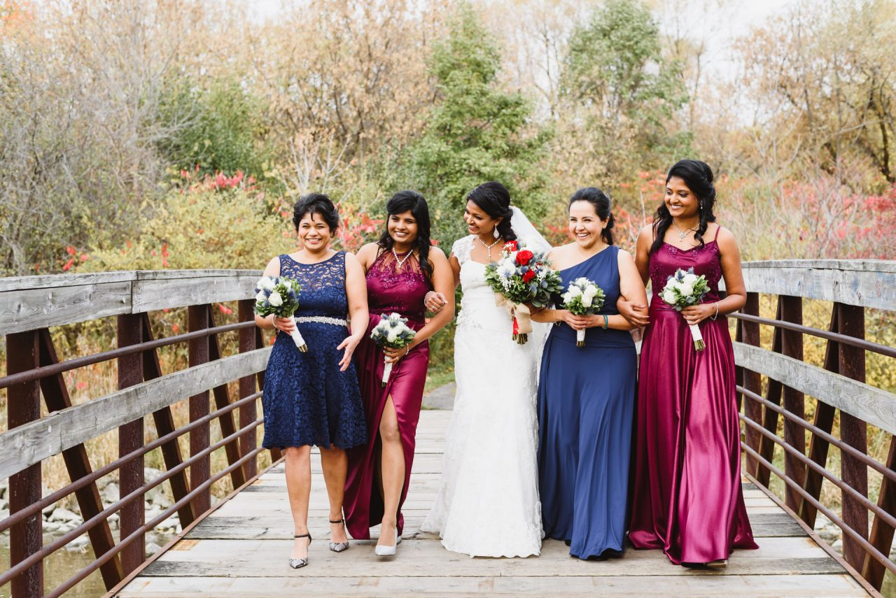 funny candid picture of bride with her bridesmaids taken at Humberwood Park Toronto