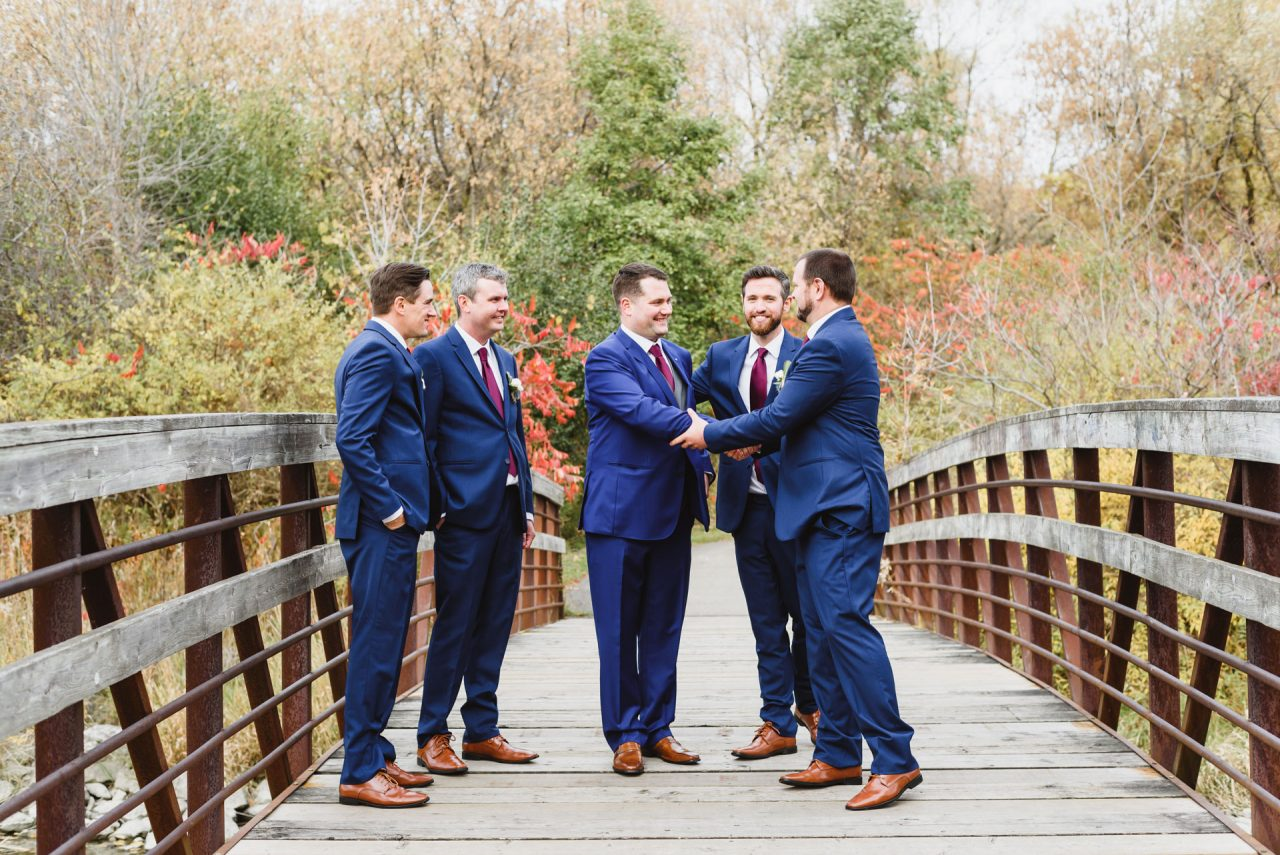 portrait of groom with his groomsman laughing