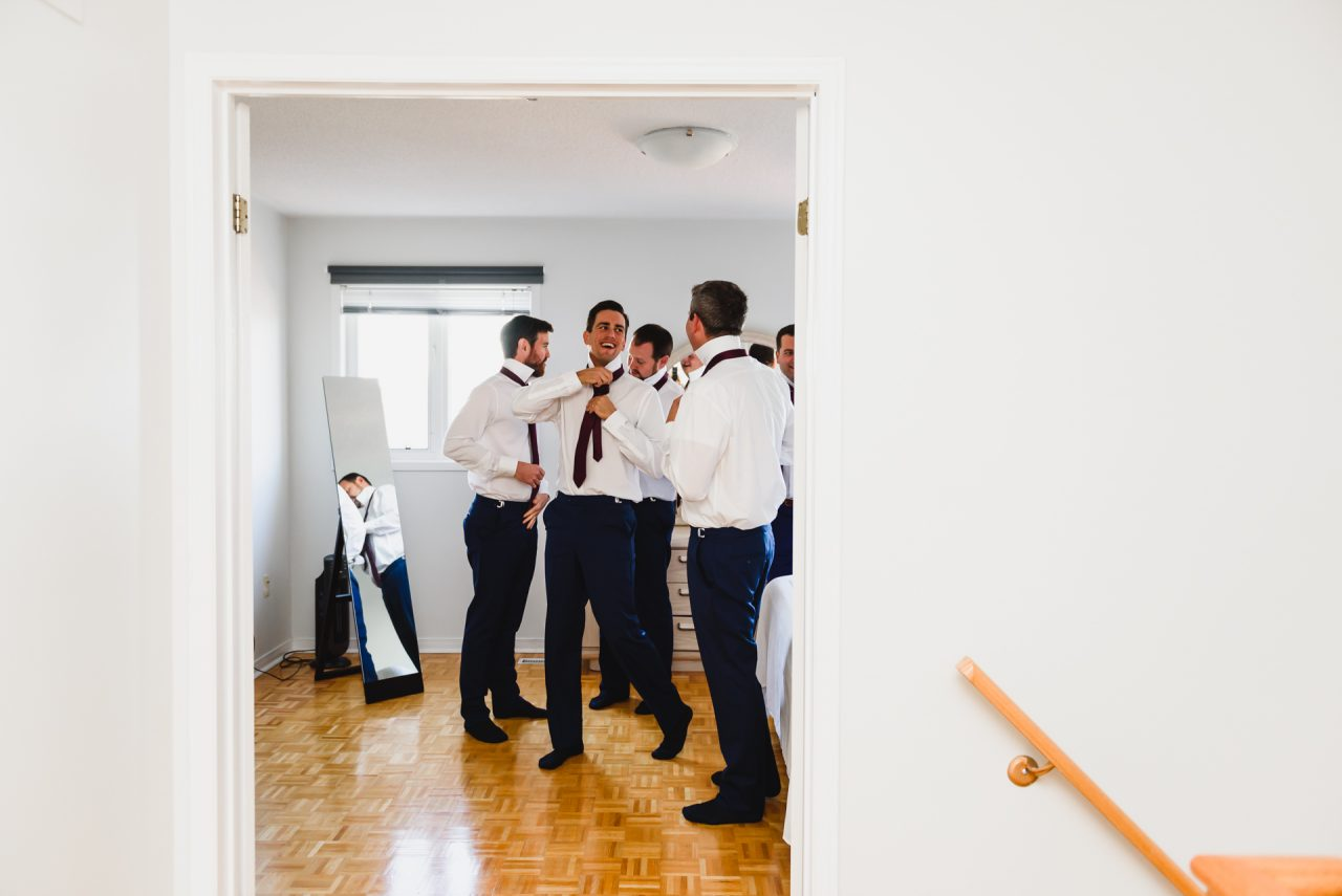groom and groomsman's getting ready in house in Mississuaga