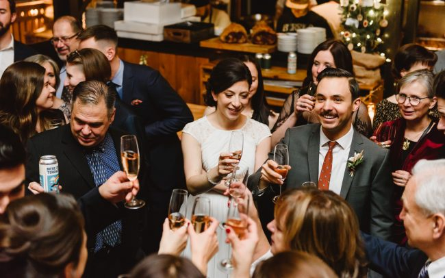 Toronto restaurant wedding reception bride and groom are drinking champagne