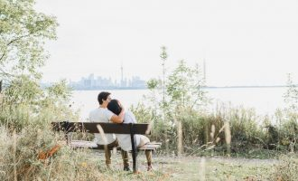 engagement photo shoot with CN Tower skyline at Humber Bay Park East