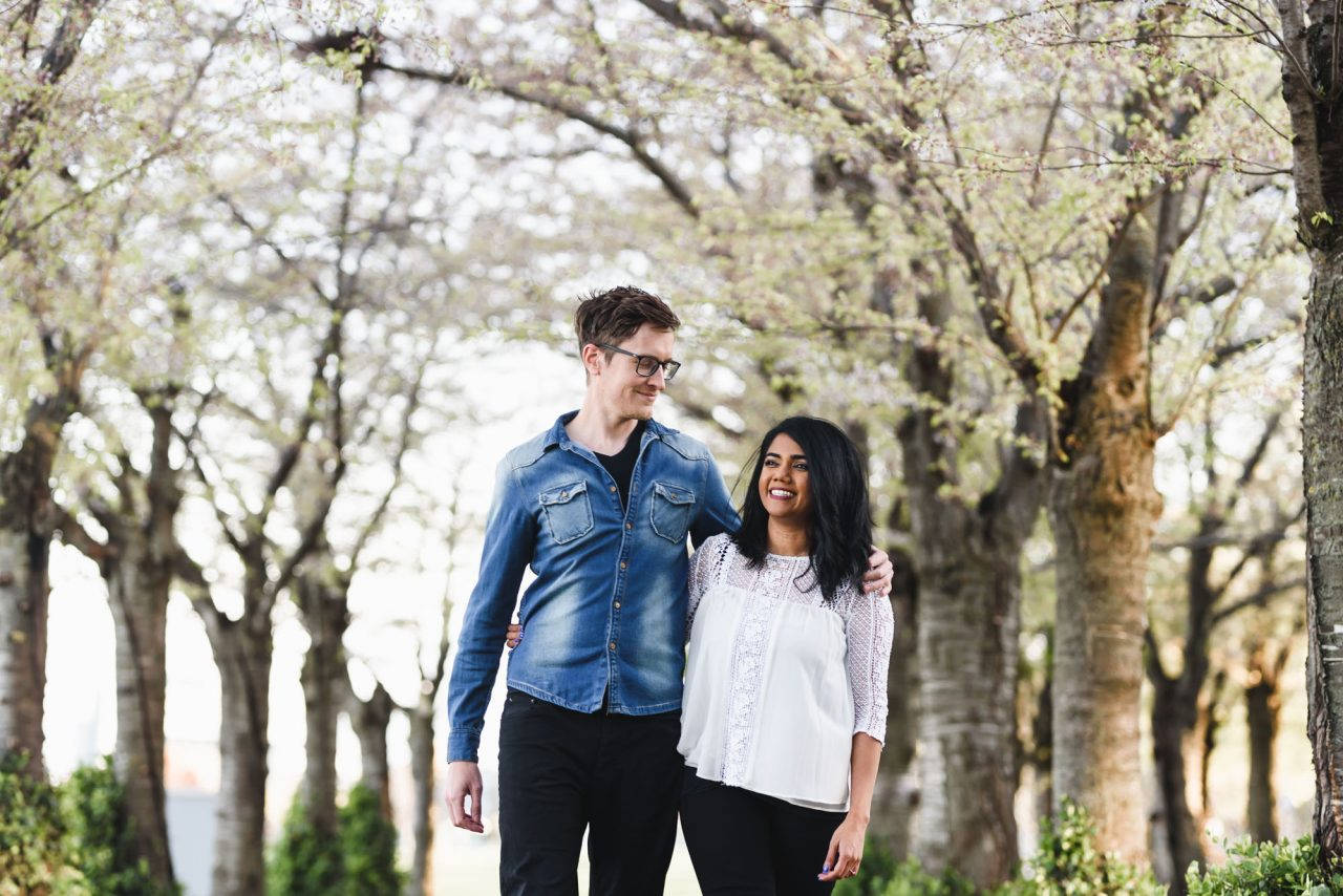 couple photoshoot at Spencer Smith Park during cherry blossom peak